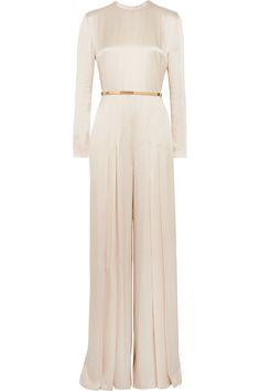 Stella McCartney's elegant jumpsuit has been designed specially for us, and we can't wait to wear it for fall galas and festive parties. This long-sleeved style is cut from lustrous champagne satin that enhances the fluid movement of the pleated, split wide-legs. Use the slim gold belt to add shape to your waist.