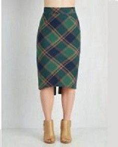 Green plaid design pencil skirt with slight tuxedo back. Materials: Cotton and Polyester