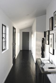 Black wood floors with white walls