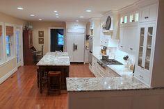 just painted the kitchen Putnam Ivory... white cab's next week, wooo hoooo.