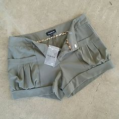 BEBE olive green shorts ADORABLE!!!! Pleated pocket shorts  Olive green color Replacement button still attached May have been worn once. Gorgeous condition.  Sz. Xs  Bundle and save or make me reasonable offer. bebe Shorts