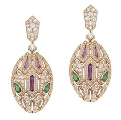 Bulgari. Embracing the house's most significant motif, the Serpenti Seduttori earrings in pink gold adopt a new shape of the snake's head to accentuate the power of the emeralds-set eyes. Price on request