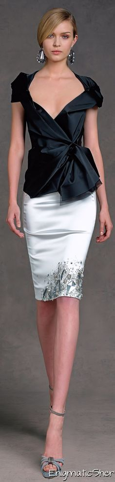 Donna Karan - black and white never had it so good, and the touch of floral at the bottom, on one side only, is genius.