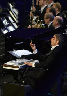 British actor Rowan Atkinson performs during the opening ceremony of the London 2012 Olympic Games on July 27, 2012 at the Olympic stadium in London.