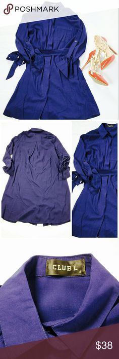 [Club L] Relaxed Shirt Dress Club L relaxed shirt dress in navy. Zip up front with tie waist. Sleeves can be worn long or 3/4 style buttoned at the elbows. Rounded hem hits at the mid thigh and falls slightly lower in back. Great outfit for work or for play. Size 2. NWOT. Club L Dresses Mini