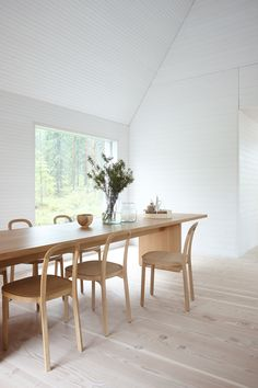 Woodnotes Siro + oak chairs. Dining room. Interior design. Wooden house. Wooden furnitures.