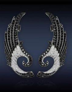 Jacob & Co- Wing Clip-On Earrings with 6.69cts Black Diamonds (314 Stones) and 1.47cts White Diamonds (86 Stones).