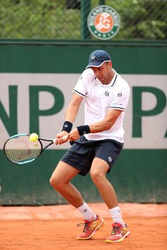 Gilles Muller of Luxembourg plays a backhand during the mens singles first round match against Ernests Gulbis of Latvia during day two of the 2018 French Open at Roland Garros on May 2018 in Paris, France. Lawn Tennis, Tennis Championships, French Open, First Round, The Championship, Wimbledon, Luxembourg, Tennis Racket, Paris France