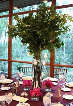 S1 Photography. Vale of Enna flowers. Hyatt Lodge Mcdonald Campus. Oak Branches. Dendrobium Orchid. Mokara Orchid. Green and Fuchsia. Centerpiece. Chicago Wedding.