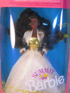 Vintage Mattel African American Summit Barbie was produced in 1990. Barbie is dressed in a beautiful gold and white gown with matching jacket with a