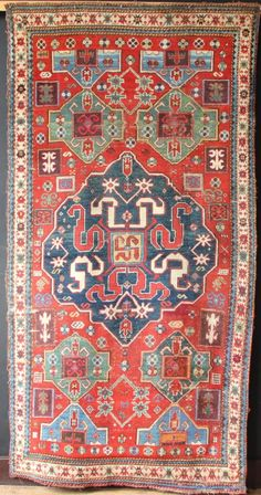Single medallion cloudband or chondzoresk karabagh, mid nineteenth century. Beautifully drawn medallion with animated cloudbands and many other interesting features, including but not limited to the green medallions top and bottom, the ...