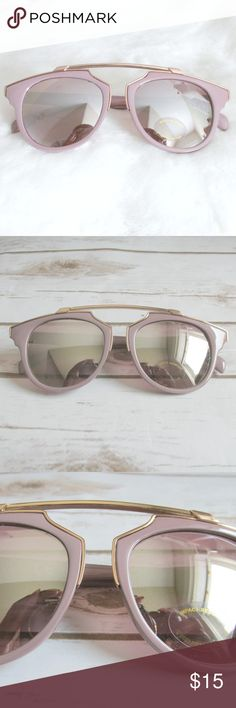 Dusty Pink Gold Bridgeless Cat Eye Sunglasses Cute pink cateye sunglasses with a gold brow bar accent. The pink is not bright or bubblegum. A dusty sophisticated pink. I love the lens on these. Silver Mirror with a touch of a pink tone.  Condition: NWT Brand: Citizen Republk Type: Sunglasses  Style: Cateye Frames: plastic Lens: Pinky silver mirror Protection: UV400   DD0.5:201804171442:004:715C Citizen Republk Accessories Sunglasses