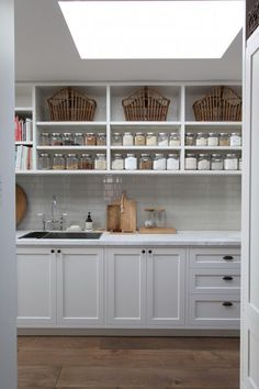 Scullery with glass storage jars on shelves