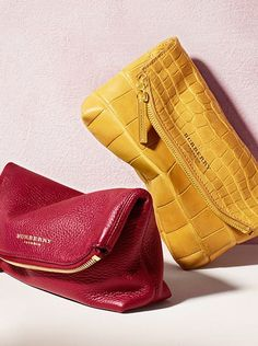Vibrant Burberry clutch bags crafted from soft textured leather for Spring/Summer 2014