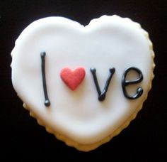 Decorated Valentine sugar cookies hearts love. $1.50, via Etsy.