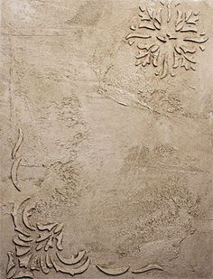 embossed design on plastered wall using the texture effects from the decorative painters products