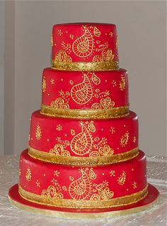Indian Paisley Wedding Cake - Indian Paisley Wedding Cake. All free hand piping with royal icing. Then painted with gold highlighter & glaze mix.