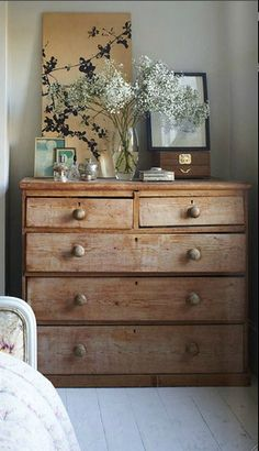 this looks beautiful. why can't I have this kind of decor talent? In less than a week, the top of that dresser would be cluttered with cheap plastic jewelry, hair bands, bobby pins, dirty drinking glasses, maybe a sock, and tons of dust. TONS.