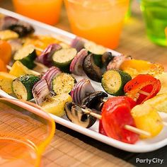 Serve up veggie kabobs! Slide on yummy squash, red bell peppers and mushrooms onto bamboo skewers. Grill on each side for 5 minutes and serve them up! Yum!