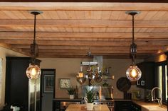 The finished Arus kitchen, showing our repurposed winch hook pendant lights: