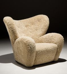 FLEMMING LASSEN (1902-1984), Tired Man armchair, 1935. Manufactured by cabinet maker A.J.Iversen, Denmark. Material wood and lamb skin. Coming up for sale on Piasa´s Scandinavian Design vs Brazilian vs American-auction, 10th of February 2015. / Piasa