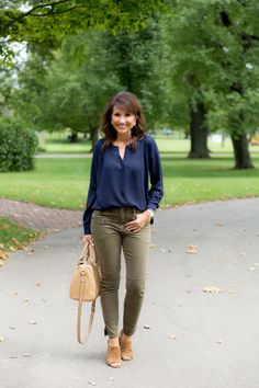 Navy Blouse + Olive Pants - Cyndi Spivey <br> One of my favorite outfit combos for fall is navy and olive so that's why I was excited to find this pretty navy blouse from Social Threads. Green Blouse Outfit, Navy Pants Outfit, Olive Green Pants Outfit, Blue Shirt Outfits, Bluse Outfit, Summer Pants Outfits, Casual Work Outfits, Mode Outfits, Navy Blouse