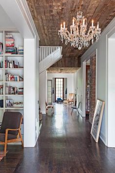 he downstairs hall in architect Nick Dryden's house features a ceiling made from 200-year-old reclaimed farmhouse wood. He says he wanted it to feel like a porch ceiling. | Photo: Caroline Allison