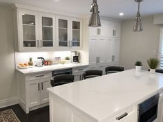 Bright & white painted cabinets, glass doors, pantries for lots of storage and beautiful island Paint Cabinets White, Painting Cabinets, Kitchen And Bath Design, Kitchen Paint, Transitional Kitchen, Transitional Style, Pantries, Custom Cabinetry, Glass Doors