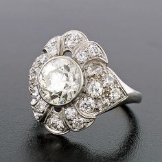 A Brandt and Son - Edwardian Platinum & Diamond Flower Cluster Ring 3.95ctw