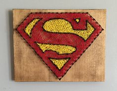 For all superman fans this would be a perfect addition to your collection! 9x11 stained wood with black nails. superman red and yellow string. Comes with a sawtooth hanger attached to the back.  This item is handmade and made to order your piece may vary from the picture in the color of wood because each piece of wood has its own character. Please allow 5-7 business days for shipment! Need a different size just send me a convo and I can create you a custom order