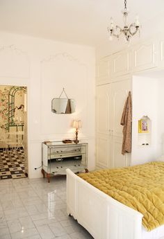 Charming Apartment with a sea view for rent In Old Nice. The apartment lies in a charming old building in Nice in the heart of the Old Town, two minutes from the beach and just off the flower market. It is filled with french charming details and decoration. #interior #france #Nice #oldtown #seaview #decor #chandelier #WallPainting #antique #french #vieuxnice #travel #visitfrance #FrenchRiviera #riviera #CotedAzur #CoursSaleya #BuildInCloset French Apartment, Build A Closet, Outdoor Spa, Unique Hotels, Nice France, Hotel Decor, Cool Apartments, Old Building, Flower Market