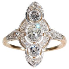 Diamond Engagement Rings This breathtaking antique diamond marquis-shaped ring was handcrafted c Each of the 27 white diamonds are set in platinum, the shank is made in gold. Wedding Rings Vintage, Antique Engagement Rings, Antique Rings, Diamond Engagement Rings, Antique Jewelry, Vintage Jewelry, Edwardian Jewelry, Engagement Jewelry, Halo Engagement