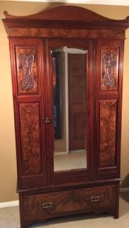 ANTIQUE EDWARDIAN ARMOIRE WITH BEVELED DRESSING MIRROR DOOR. THIS HANDSOME WARDROBE FEATURES CARVED AND BURL VENEER PANELS, DOVETAIL JOINERY, BRASS HARDWARE AND A SLIGHTLY DOMED TOP. IT IS IN CLEAN, ORIGINAL CONDITION BUT PLEASE NOTE, THE INSIDE SHELVES ARE A NEWER ADDITION. 63H X 44W X 18D