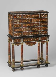 Cabinet, Pierre Gole, c. 1655 - c. 1660. Pine, walnut, bone,  ebony, yew, holly, maple (wood).  Ivory, bronze, gilding. Gole, originally from Bergen in what is now the province of Noord-Holland, established himself in Paris around 1643. Already in 1651 he was appointed court cabinetmaker by King Louis XIV. This cabinet is decorated with floral marquetry, an ornamental technique that was probably invented and disseminated by Gole. -Rijksmuseum Amsterdam-