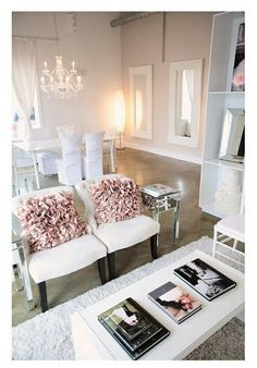 A little uber feminin for my taste, but I like the idea of having two chairs like this is my home office and a table with design books on display.