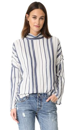 ¡Cómpralo ya!. Fred And Sibel Button Up Cold Shoulder Shirt - Stripe. Slinky, woven fabric lends easy drape to this striped Fred and Sibel mock neck top. The button panels at the shoulders can be worn open for a cutout look. Long sleeves. Hidden back zip. Fabric: Slinky weave. 62% viscose/35% acrylic/3% linen. Dry clean. Imported, Turkey. Measurements Length: 24.5in / 62cm, from shoulder Measurements from size S. Available sizes: L , tophombrosdescubiertos, sinhombros, offshoulders…