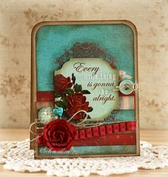 gorgeous teal and red; she stamped a map on the teal patterned paper
