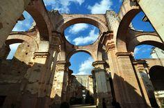 WIndows to the heavens through the ruin of an antique church