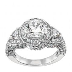 """Diamond Nexus' """"Caramia"""" - Center Stone available in various sizes ranging between 0.76-1.49 carats, with 65 round Brilliant and Triangle cut accents on a double-prong setting. $1,635-$1,879"""