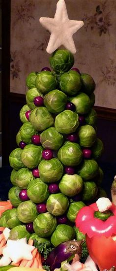 This Christmas tree makes a stunning holiday centerpiece for any arrangement of veggies or fruits. For more ideas from Natalya check out this link.