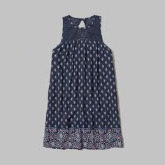 lightweight and pretty with an easy shift silhouette, lace paneling at hem and neckline with keyhole cutout at back, imported