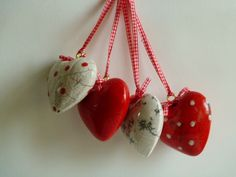 Hearts in Raku with red check ribbon and bow