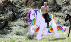 Riding a rainbow pony while bare-chested.