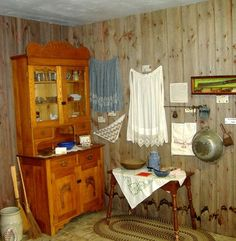 """Laura Ingalls Wilder museum in Walnut Grove, MN - how Laura's family's  """"front room"""" would have looked, with some additional items they would have used on display"""