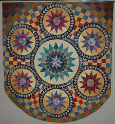 Google Image Result for http://www.faithfulcirclequilters.com/gallery/albums/album35/015_Smallest_of_3_Bristol_Star_quilts_based_on_mosaic_in_Bristol_cathedral.sized.jpg