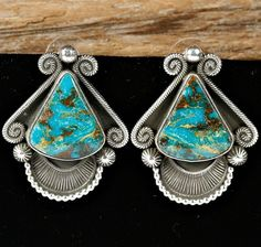 Earrings | Rick Martinez (Navajo).  Sterling silver with Indian Mountain Turquoise.