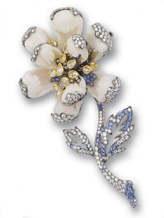 A coral, sapphire and diamond brooch
