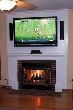 Mounting a TV above a fireplace and hiding the cords by stacy