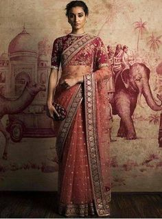 This is a beautiful marokn sari. The blouse is heavily made and looks gorgeus under the netting sari. The border is heavy and looks absolutely gorgeous. The hair is pulled up into a classic updo. Overall that sari looks breathtaking. Sabyasachi Sarees, Indian Sarees, Bollywood Saree, Bollywood Fashion, Bollywood Celebrities, Lehenga Choli, Bridal Lehenga, Saree Wedding, Wedding Wear
