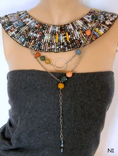 Dabanga recycled paper bead necklace made from pages of Nat'l Geogrpic magazine ; 0